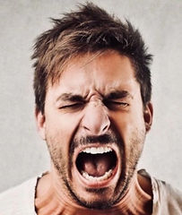 Aggressive Man Screaming with Anger