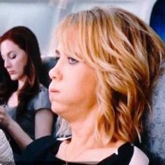 Fearful lady sitting in a plane