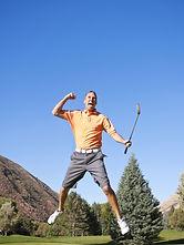 Golfer sinks a putt and celebrates