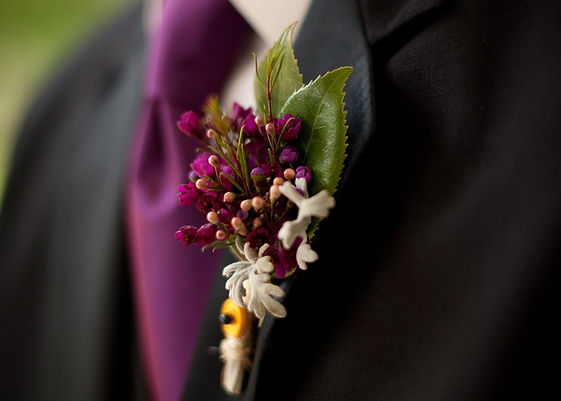 Purple groomsmen boutonnière