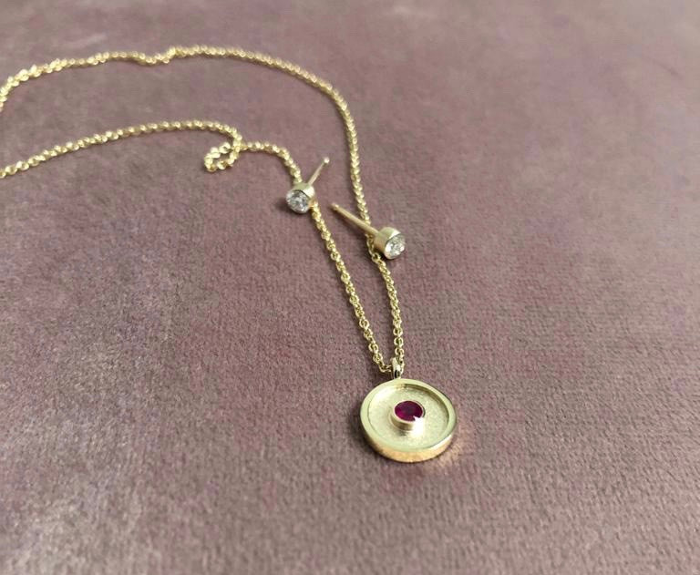 Ruby pendant, diamond earrings