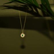 Emerald Amulet necklace still life