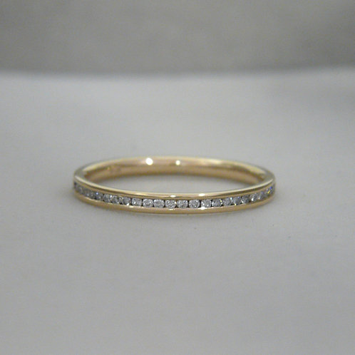 gold and diamond eternity ring, channel set, Handmade in Dublin.