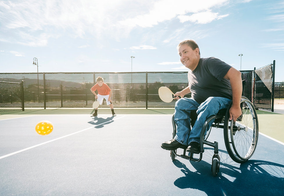 NDIS customer playing racquet ball