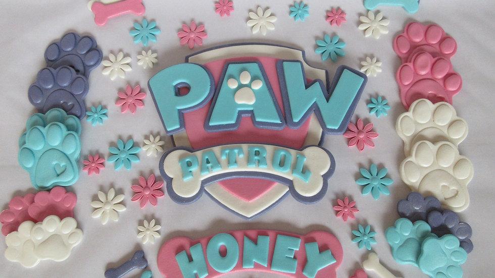 Paw patrol shield edible cake topper.