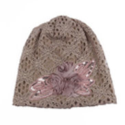 Lace cap with flower accent