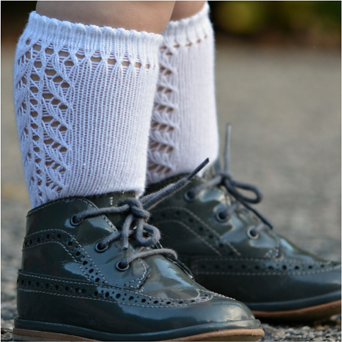 Baby boy wearing Condor 2592/2 White Openwork Knee High Sock and Shoes