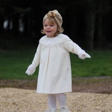 Girl wearing Spanish Patachou Cream Velvet Dress