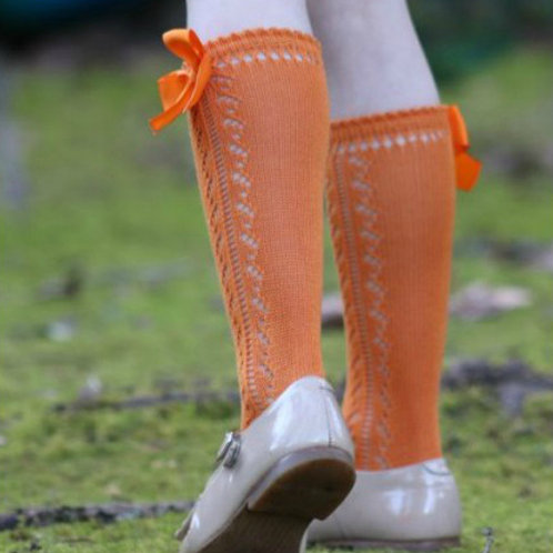 Girl wearing Filton BS30/B Orange Bow Knee High Sock with Shoes