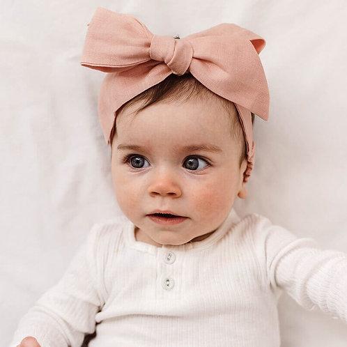 Baby Girl wearing Snuggle Hunny Linen Bow Headband Rust