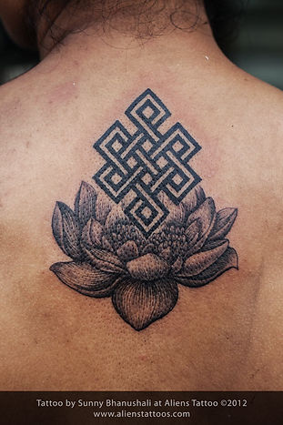Buddhist Knot on Lotus Tattoo