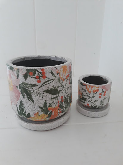Small orange and pink floral indoor pot with saucer