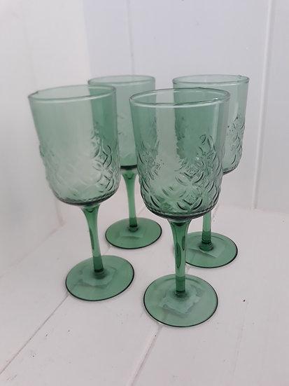 Green wine glasses beautiful stem mist