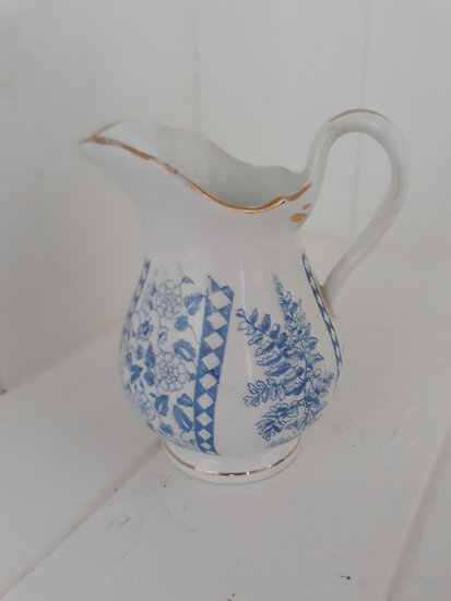 Pale blue and white small jug with gold edging detail