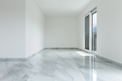 Interior of empty apartment, wide room with marble floor.jpg