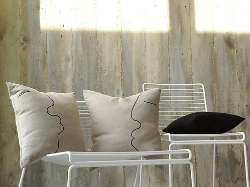 Natural linen cushions with black one line drawing in modern interior