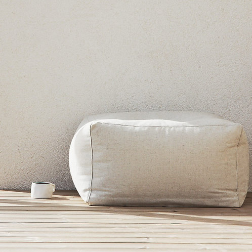 Linen pouf in Scandinavian interior