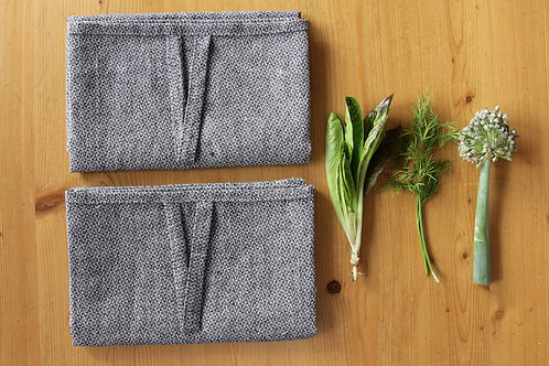 Modern kitchen towels and fresh salad leaves