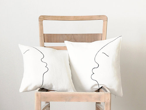 Modern white linen illows with one line drawing black