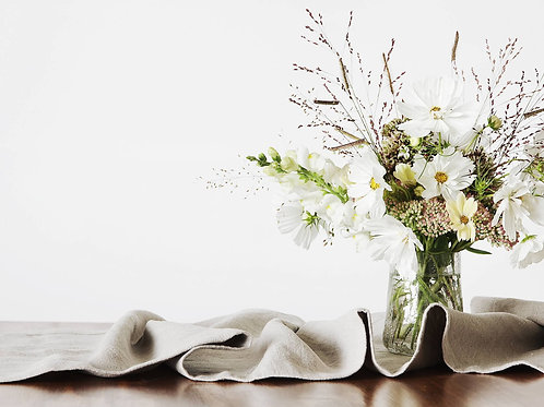 Summer table decor with natural linen runner