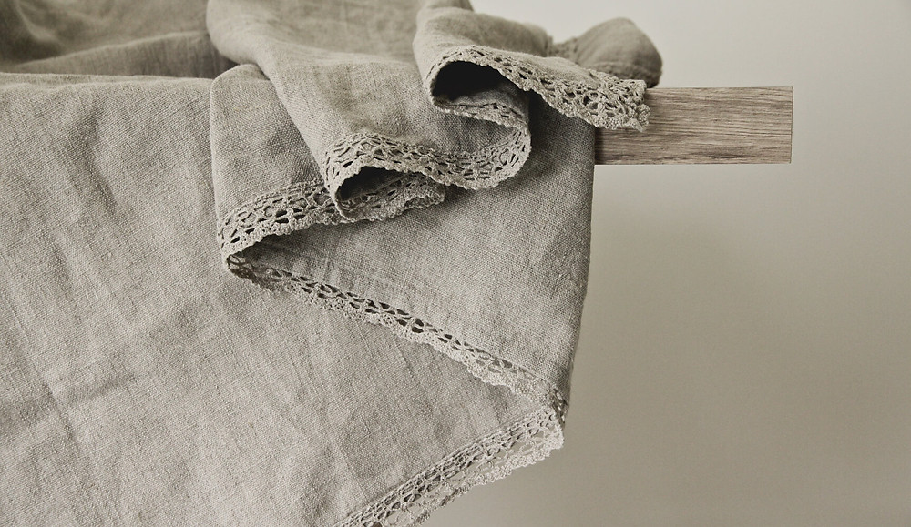 Laced natural linen tablecloth on modern table