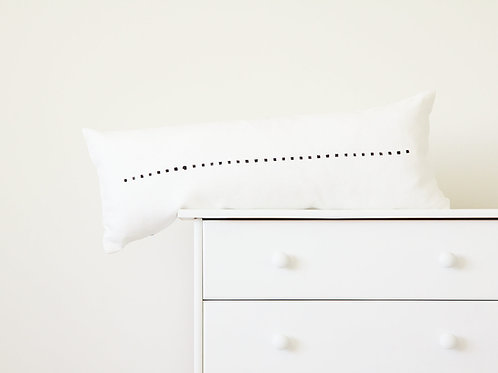 Black and white long pillow in white interior