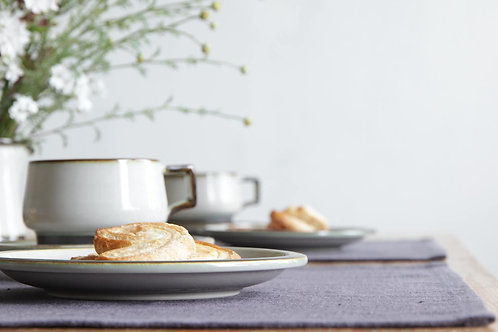 Scandinavian style table setting with gray linen placemats