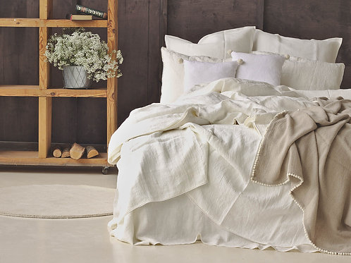 Beautiful washed white soft linen bedding in modern interior