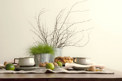 Simple modern table setting with spring green table decor