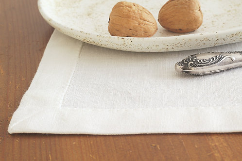 White linen placemat on rustic table