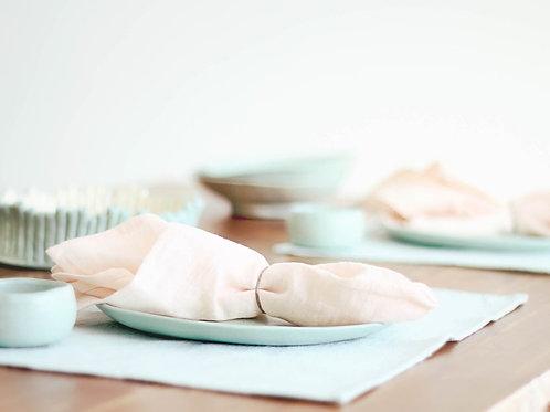 Pale blush peach napkin and modern mint tableware