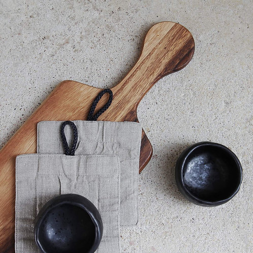 Modern linen cup coasters and black modern pottery