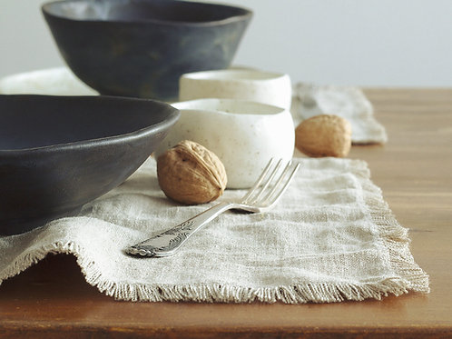 Rustic linen burlap placemats with modern tableware on rustic table