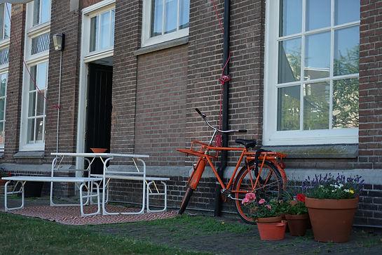 IGGA | De praktijk met de oranje fiets
