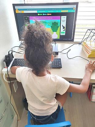 Little girl with desktopSM.jpg