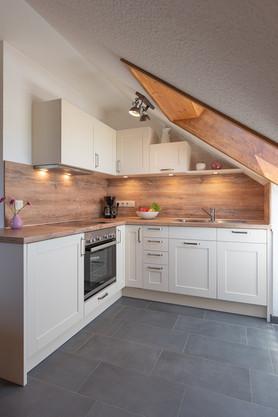 Foto  Ferienwohnung Küche mit Schräge