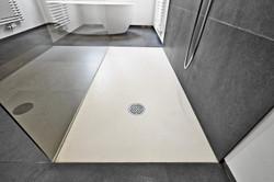 bigstock-Corian-Floor-And-Drain-116011793