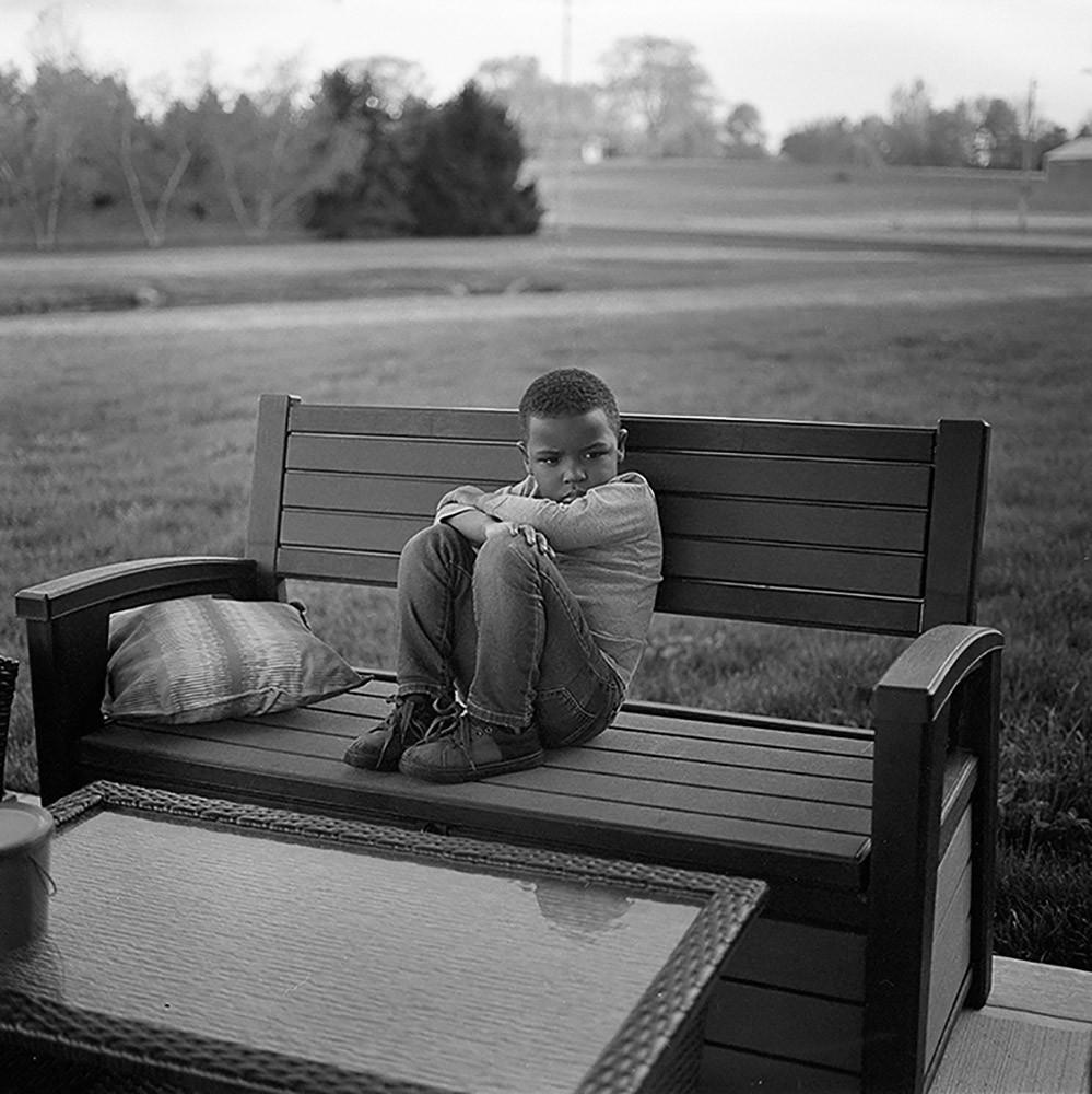 LJ sitting on bench