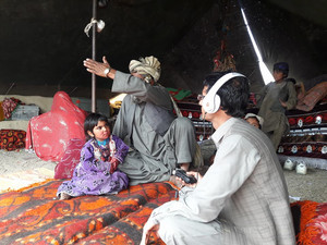 The Nargis Radio Health Programme team visits an ill family in nangrahar province to talk about thei