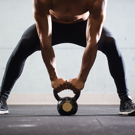 Muscular%20Man%20Lifting%20Kettle%20Ball