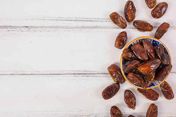 elevated-view-fresh-pitted-dates-white-w