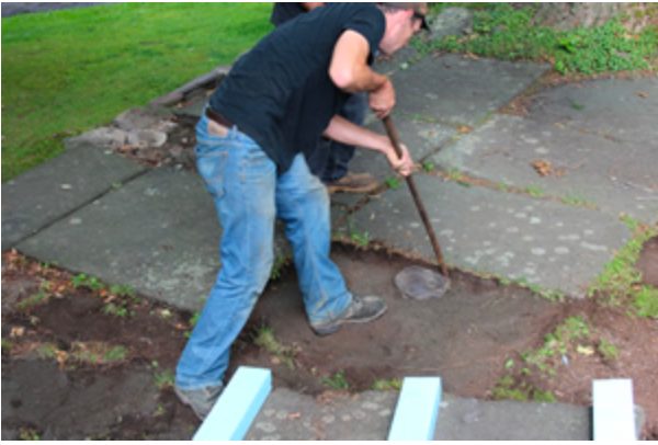Reclaiming through removal of existing blue stone sidewalk material.