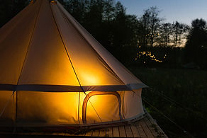 camping-canvas-bell-tent-glows-at-night.