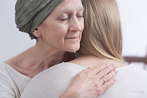 Woman chemo patint hugging another.jpg