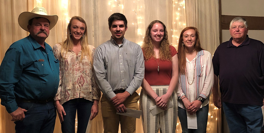 Photo- L to R – Randall Pugh, VP and David Shores, President, present college scholarships to Lilly Mahaney, Lucas Clark, Greta Ball, and Kalie Mahaney (not pictured-Cody