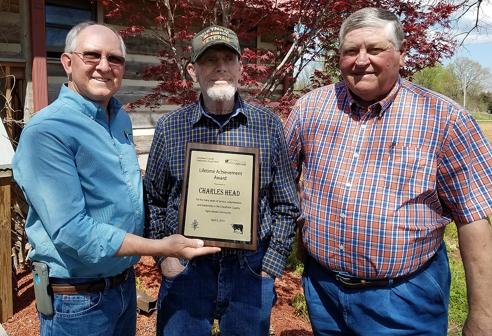 Photo-Association President, David Shores and Ronnie Barron, Cheatham County Extension Director, present the Lifetime Achievement Award to Mr. Charles Head.