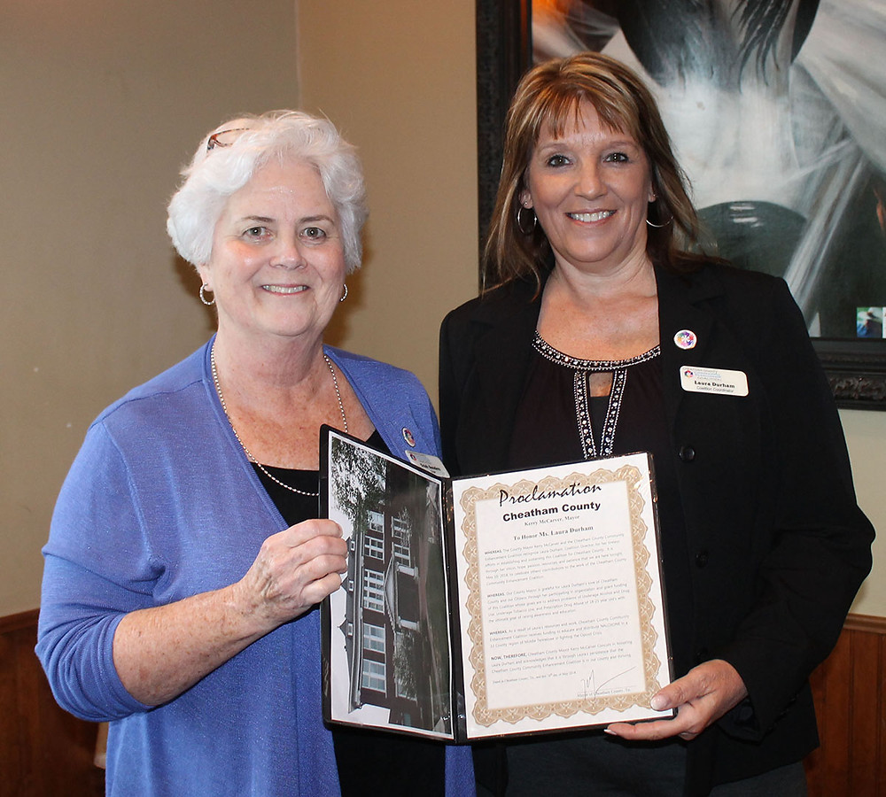 Cheatham County Community Enhancement Coalition Chairperson Trish Sanders presents CCCEC Director Laura Durham (right) with a proclamation from Cheatham County Mayor Kerry McCarver.
