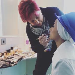 Applying makeup to Amerah Saleh