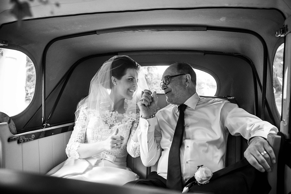 Bride and her Dad is wedding car outside Brewood church