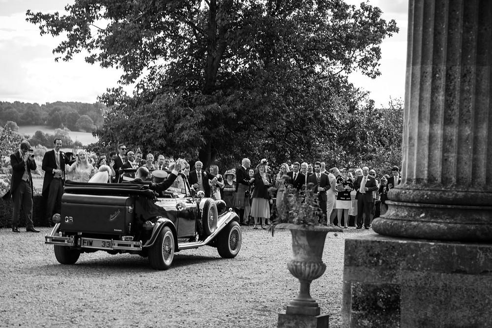 Bride & Groom arriving in vintage car at Whitbourne Hall